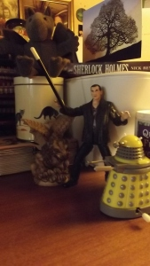 The 9th Doctor rallies the troops, using a rather large wand.