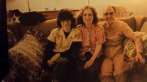 (l to r) Me, Mom, & Dad, early 1980s. Alex the cat is on the sofa.