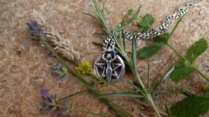 Another photo of my necklace, and some summer herbs, including woad (small yellow flowers)