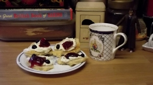 Scones with cream, jam, and blueberries: I say!